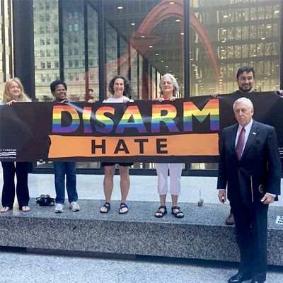 "Hoyer stands together with Chicagoans for gun violence prevention holding a rainbow banner that says ""Disarm Hate"""