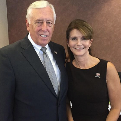 Hoyer stands with Anna Throne-Holst, the woman who helped fix their local finances and co-founded an elementary school to meet the needs of all students